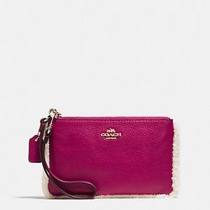 NWT Coach pink shearling wristlet!! PRICE FIRM